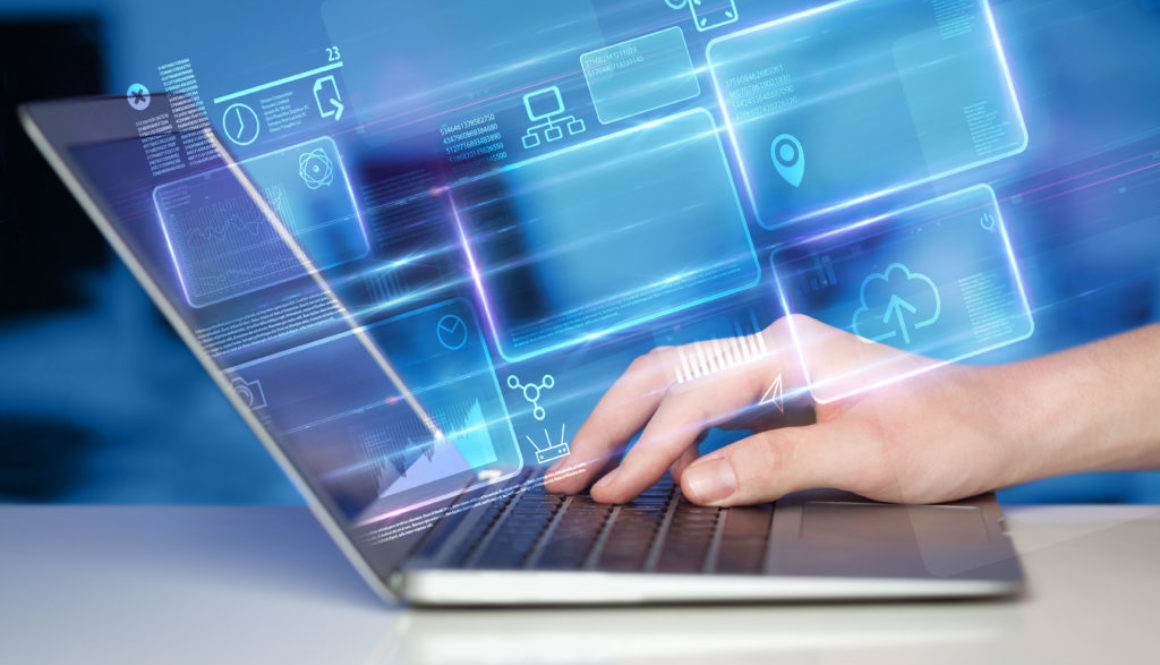 Hand using laptop information database concept
