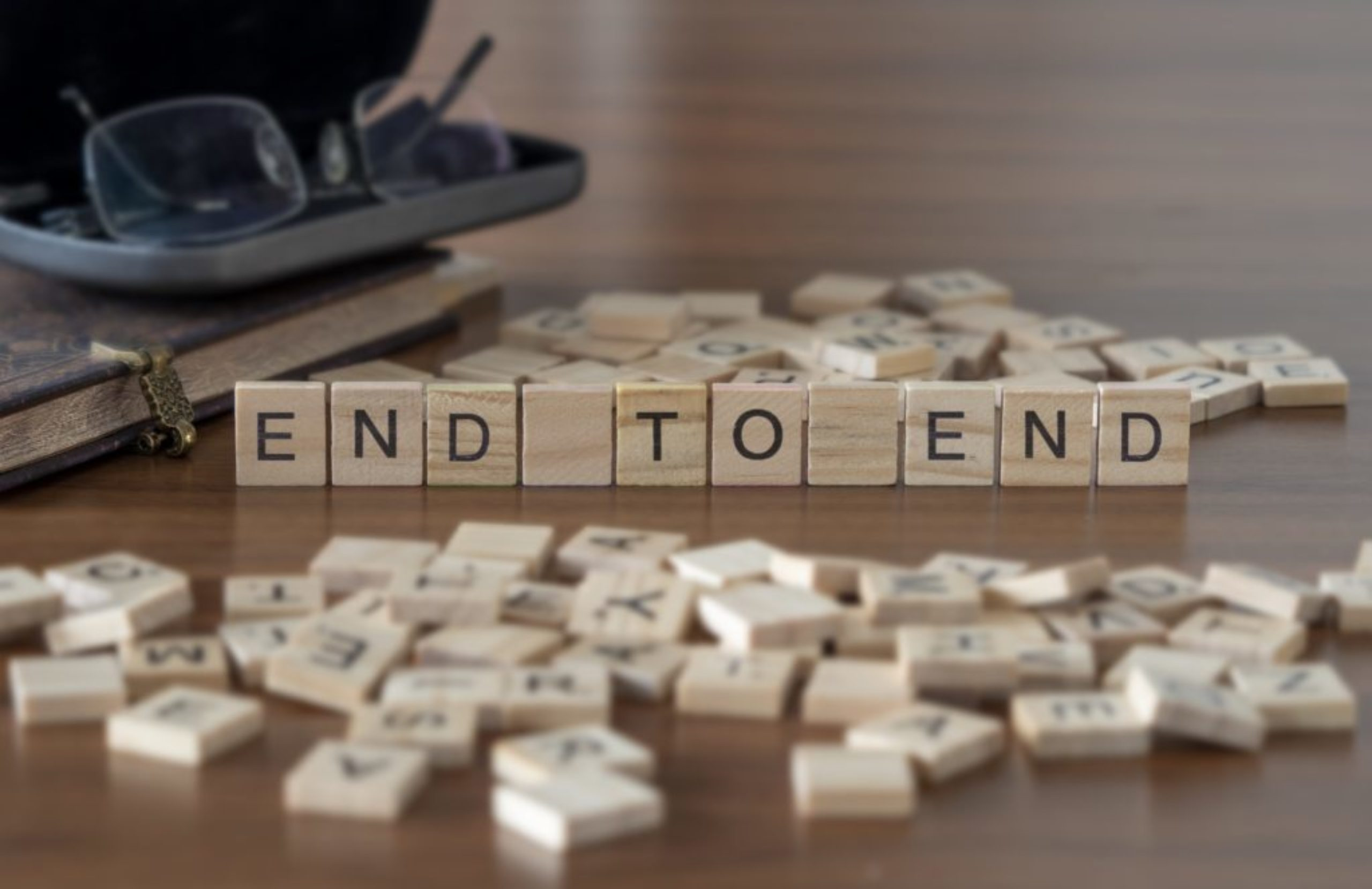 End To End the word or concept represented by wooden letter tiles