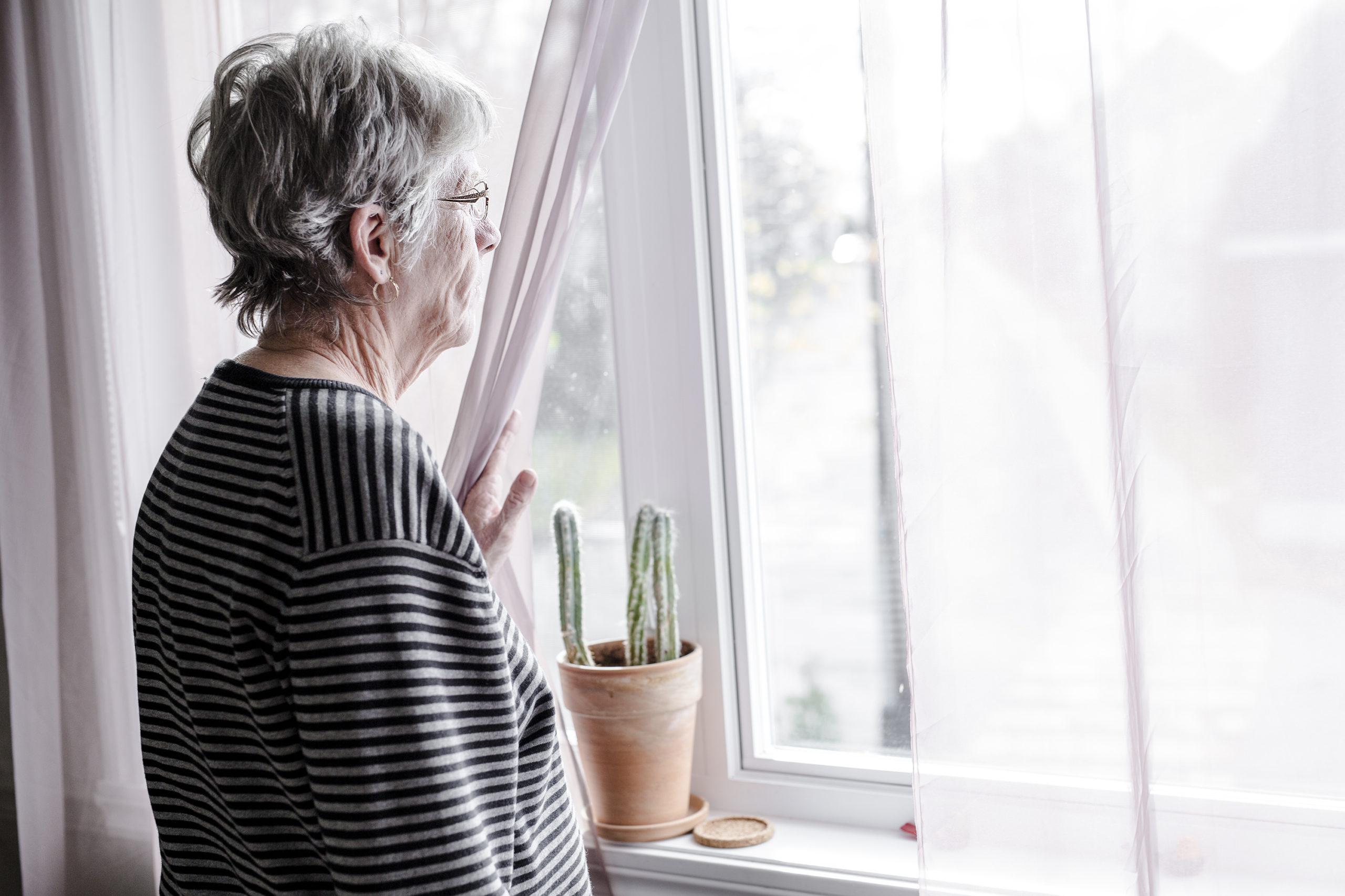 worried senior woman at home felling very bad